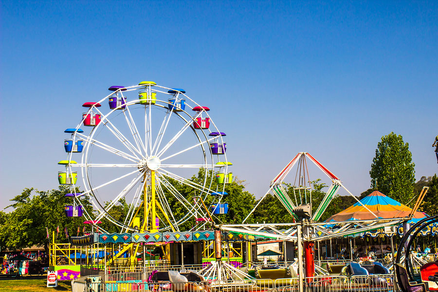 Carnival Rides Including Ferris Wheel At Small County Fair